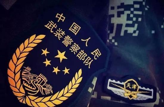 武警部队明日起统一佩戴新式标志服饰(图)
